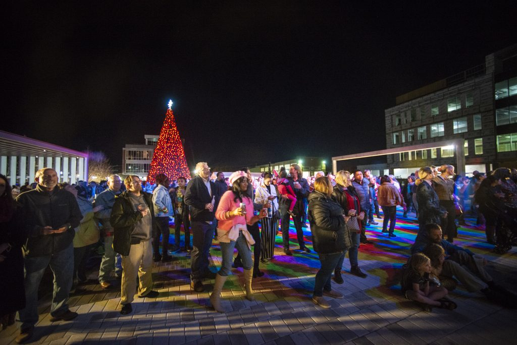 The crowd dances in Argenta Plaza after the lighting of the new 42-foot Christmas tree in North Little Rock.